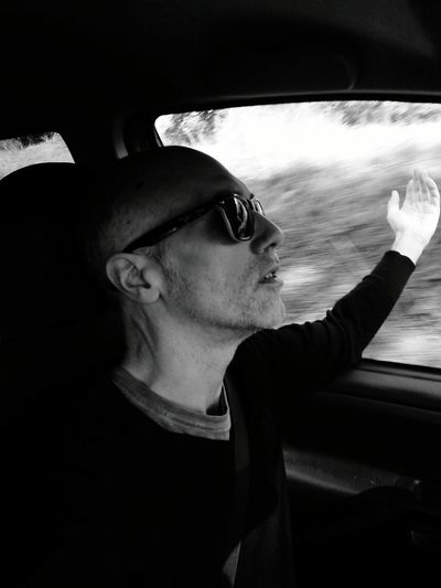 Need to drive...to breathe...to feel the air...music at full volume in the car...and no destination... One Man Only Driving Human Face Thinking About.. Portrait Destination Unknown Black And White Photography In The Countryside Adult