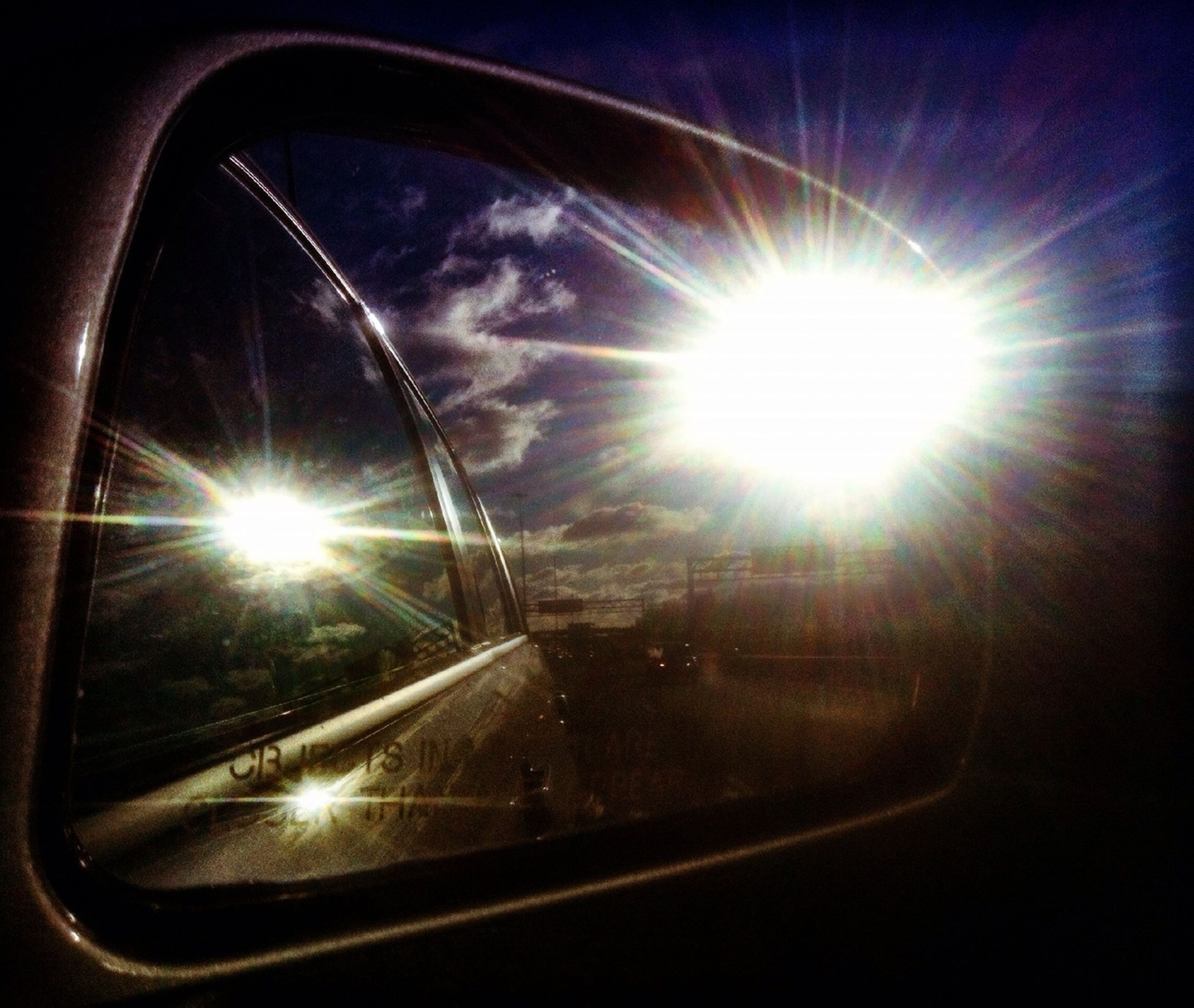 sun, transportation, lens flare, sunbeam, mode of transport, glass - material, land vehicle, car, sunlight, indoors, window, transparent, low angle view, sky, vehicle interior, bright, travel, no people, shiny, reflection