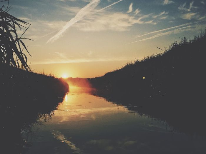 Scenic view of sunset over river