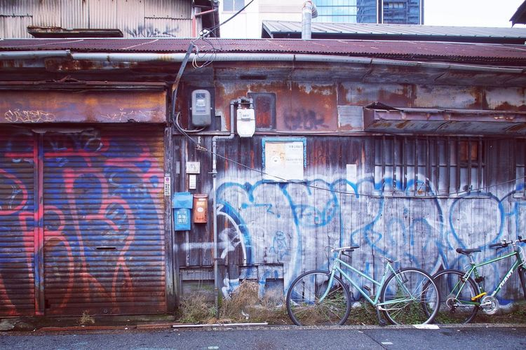 Bike Parking Walking Around Bycicle Bike Japan Old Town OSAKA 中崎町 Building Exterior Architecture Built Structure Day No People Building Graffiti Wall - Building Feature Wall Brick Metal Door City Damaged Brick Wall