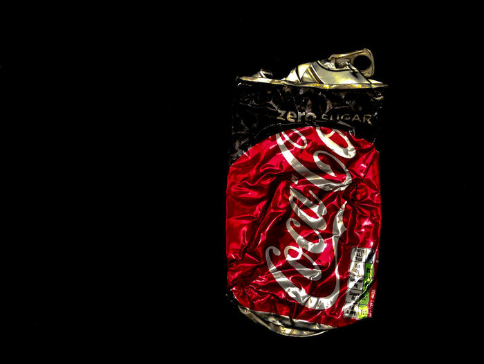 Coca Cola Crumpled Food And Drink Aluminium Can Black Background Close-up Cocacola Container Copy Space Cut Out Emotion Gift High Angle View Indoors  No People Protection Red Reflection Shiny Single Object Still Life Studio Shot Surprise Wrapped