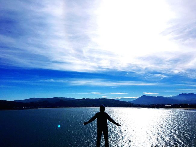 One Person Sky Water Scenics Mountain Beauty In Nature Cloud - Sky Real People Tranquil Scene Rear View Nature Mountain Range Day Outdoors Lake Tranquility Top Of The World KINGDOM IPhoneography Flying High