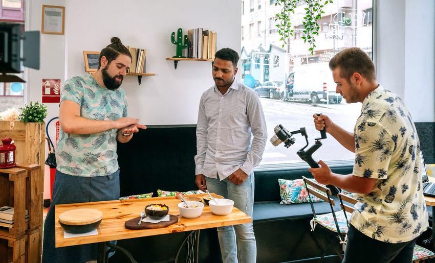 People recording video in restaurant
