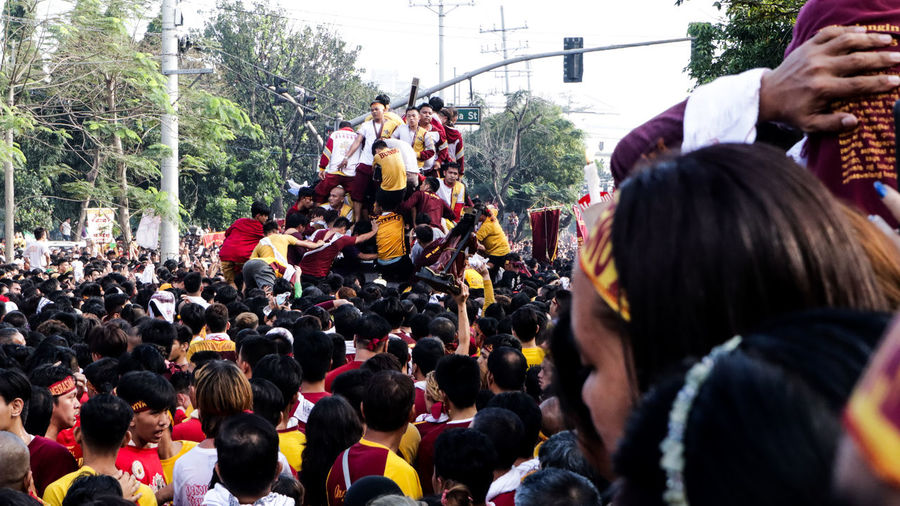 feast of Black Nazarene Unity Sacrifice Tradition Filipino Philippines Cultures Festival Crowd Flower Men Women Togetherness Standing Headshot Festival Goer Protestor Atmosphere Protest Riot Marching Political Rally Parade Audience Bauble Marching Band Military Parade Banner - Sign Live Event Fan - Enthusiast