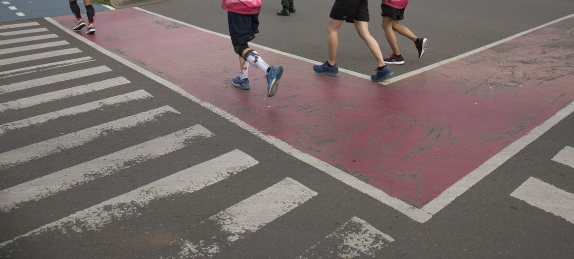 Running Low Section Real People Human Leg Human Body Part Body Part Group Of People Sport Lifestyles Road Road Marking Symbol Marking Men People Leisure Activity Sign Healthy Lifestyle Day City High Angle View Outdoors Human Limb Marathon