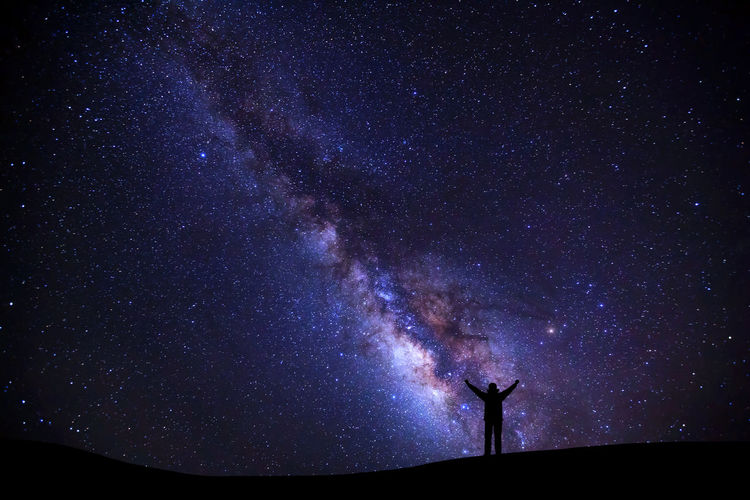 Astronomy Space Night Star - Space Galaxy Sky Scenics - Nature Beauty In Nature Star Star Field Nature Silhouette Milky Way Tranquil Scene Tranquility Standing Infinity Low Angle View One Person Outdoors Space And Astronomy