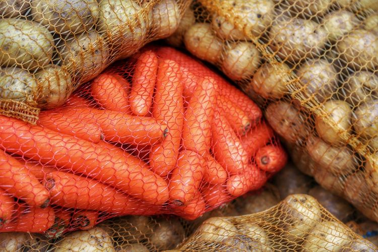 Stack Of Potatoes And Carrots In Sack