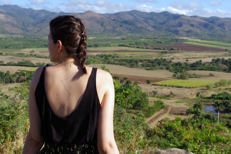 Rear view of young woman looking at mountains