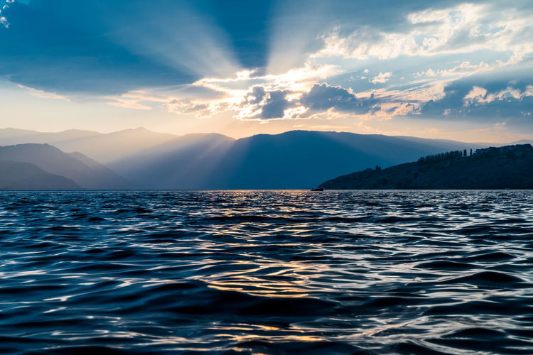 God Rays Over Lake Chelan Sky Beauty In Nature Scenics - Nature Water Cloud - Sky Sunset Tranquil Scene Tranquility Idyllic Nature Non-urban Scene No People Waterfront Sunlight Outdoors Lake Lakeview Lake Chelan PNW Ncw Pacific Northwest  God Rays Mountain