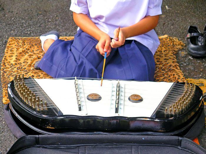 Girl Playing Music On Street