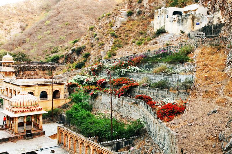 High angle view of hanuman temple by mountain at galtaji