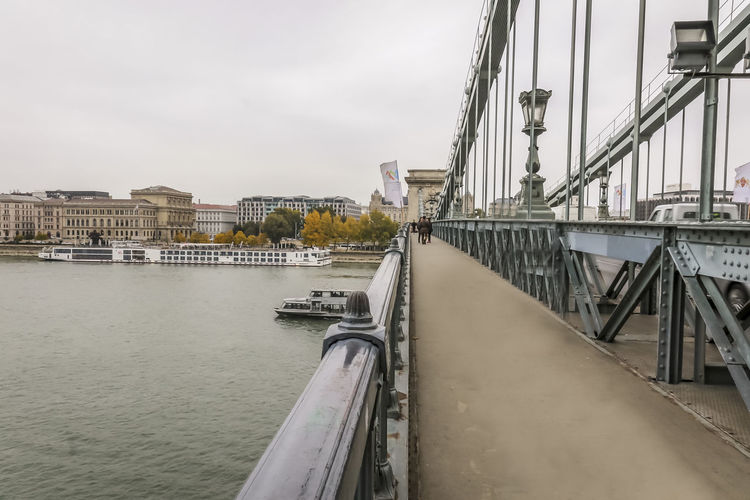 Chain bridge On Danube river Autumn Colors Budapest Cruise Liner Hungary Riverside Tourist Attraction  Ancient Structure Architecture Boats Bridge - Man Made Structure Building Exterior Built Structure Chain Bridge City Day Europe History Historical Old Achitechture Old Buildings Outdoors River Sky Tourism Water Waterfront