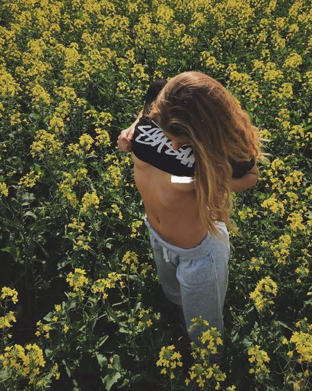 Playing in the Canola fields with Andrea Flower Leisure Activity Long Hair Lifestyles Leaf Freshness Casual Clothing Park - Man Made Space Summer Growth Yellow Beauty In Nature Green Color Plant Day Nature Person Young Adult Outdoors Abundance