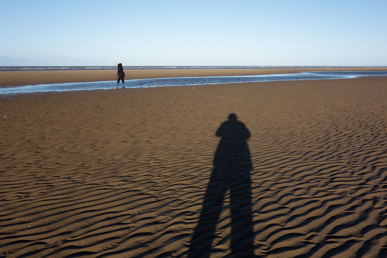 The long and short of it, Ainsdale Beach. Adult Adults Only Arid Climate Beach Beauty In Nature Clear Sky Day Eyesight Focus On Shadow Horizon Over Water Leisure Activity Men Nature Only Men Outdoors People Real People Refraction Sand Sand Dune Sea Shadow Sky Sunlight Two People
