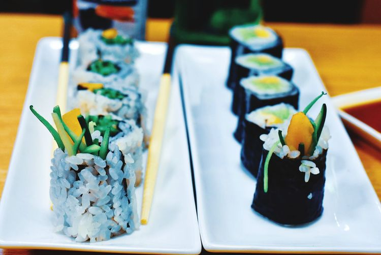 Close-up of sushi served in plates on table
