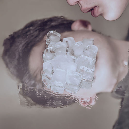 Cropped Image Of Man With Ice Cubes On Table