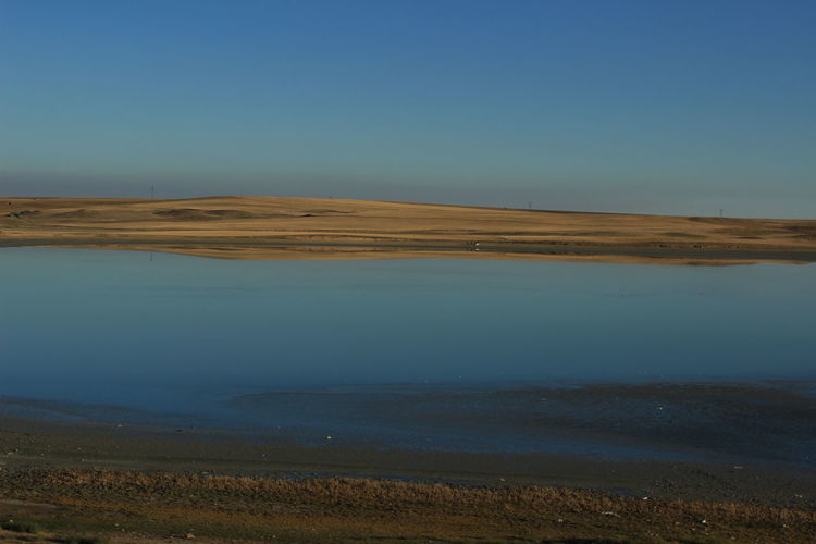 Arid Climate Beauty In Nature Blue Clear Sky Climate Copy Space Day Environment Idyllic Lake Land Landscape Nature No People Non-urban Scene Outdoors Remote Scenics - Nature Sky Tranquil Scene Tranquility Water