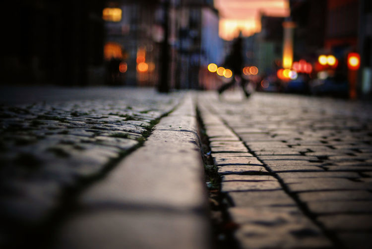 Surface level shot of cobbled street during sunset