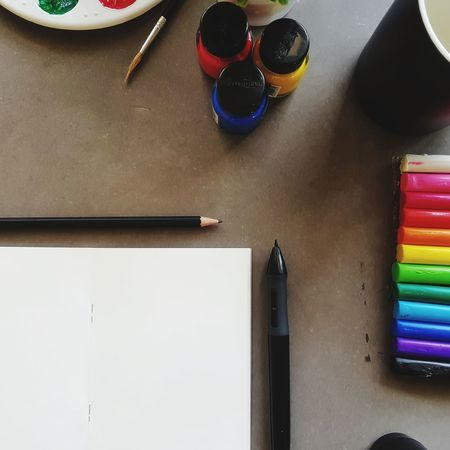 Multi Colored Desk High Angle View Color Swatch Colored Pencil Desk Organizer Writing Instrument Fountain Pen Office Supply Pencil Sharpener Art And Craft Equipment Watercolor Paints Sketch Pad Crayon Pencil Paintbrush Ink Well Paper Clip Eraser Pencil Shavings