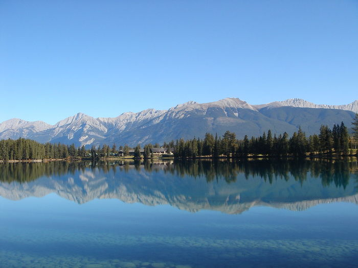 Beauty In Nature Blue Clear Sky Day Idyllic Lake Mountain Mountain Range Nature No People Outdoors Reflection Scenics Sky Symmetry Tranquil Scene Tranquility Water Waterfront カナダ 山 樹木 池 空 青空 EyeEm Selects Go Higher