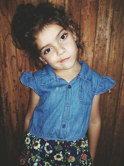 Their is a garden in her eyes, where roses and white lilies flow. Portrait Looking At Camera Childhood Smiling Child Children Only Girls Wood - Material People One Girl Only Happiness One Person Blue Indoors  Day Denim Jacket Close-up Adult