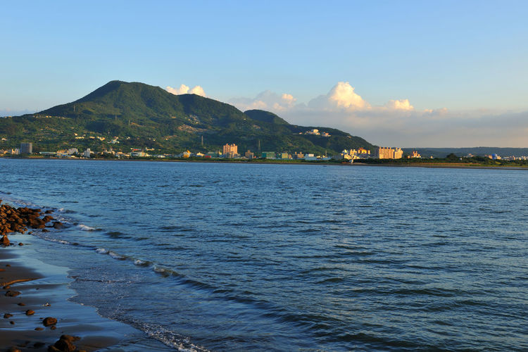 Quiet sea, a beautiful landscape, in the new Taipei is a fresh water area Fisherman's Wharf Romantic Architecture Beauty In Nature Building Exterior Day Freshwater Mountain Mountain Range Nature New Taipei City No People Outdoors Peaceful Scenics Sea Sky Tranquil Scene Tranquility Water Waterfront