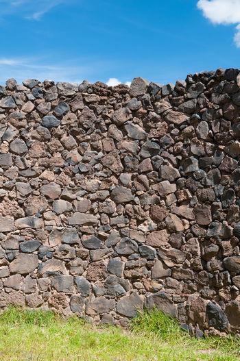 View of rocks on field against sky