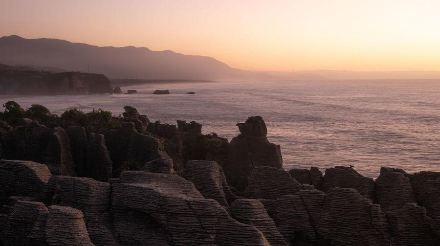 Unusual rock formations,oceans coast during sunset. punakaiki pancake rocks, west coast, new zealand