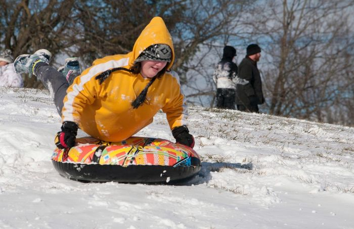 Getting some air time. Innertube Tube Winter Exciting Happy Fun Child Kid Childhood Hill Yellow Air Airtime Sledding Snow ❄ Winter Snow Cold Temperature Helmet Warm Clothing Headwear Outdoors One Person Day Real People Sport People Full Length Adventure Nature