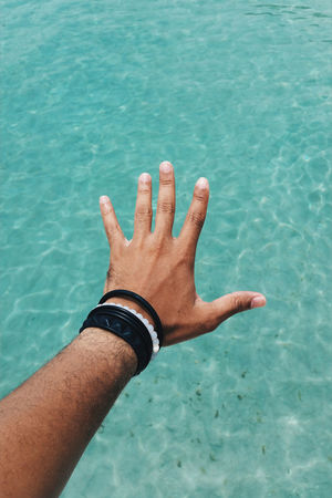 Outstretched arm over the Caribbean sea Beacelet Beach Blue Close-up Day Fingers Hand Human Body Part Human Hand IPhone Male Male Hand Mobile Nature One Person Outdoors Outstretched Outstretched Hand Personal Perspective Phone Reaching Reaching Out Sea Tan Water