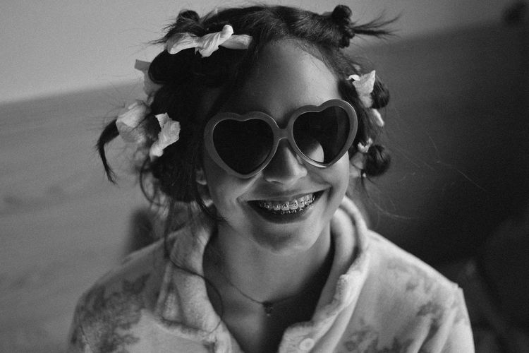 Lolita's Life: Home Alone Fun Happiness Black And White Braces Cheerful Childhood Close-up Day Elementary Age Enjoyment Fun Girls Happiness Headshot Lifestyles Looking At Camera One Person Outdoors People Portrait Smiling Sunglasses Teenager Toothy Smile Young Adult