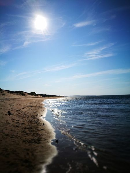Seaside stroll... Cavendish Prince Edward Island Travel Destinations Leicagraphy Leicaexplorer Sunlight Glitter Shimmery Wave Ocean Sea Sand Water Sky Nature Horizon Over Water Beauty In Nature Scenics Sunlight Tranquility No People Outdoors Tranquil Scene