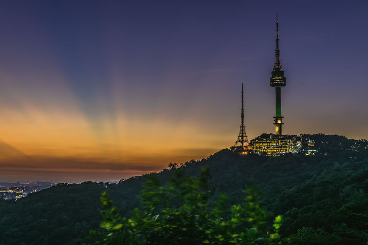 Twilight Seoul Tower in Spring at south korea. Twilight Seoul Tower In Spring At South Korea. Architecture Building Building Exterior Building, City, Seoul, Skyline, Finance, River, Panorama, Downtown, Sky, Water, Travel, Architecture, View, Tourism, Urban, Night, Landmark, South, Cityscape, Korea, Blue, Landscape, Scene, Tower, 63 Built Structure City Communication Global Communications Nature No People Orange Color Outdoors Sky Spire  Sunset Tall - High Tourism Tower Travel Travel Destinations Tree