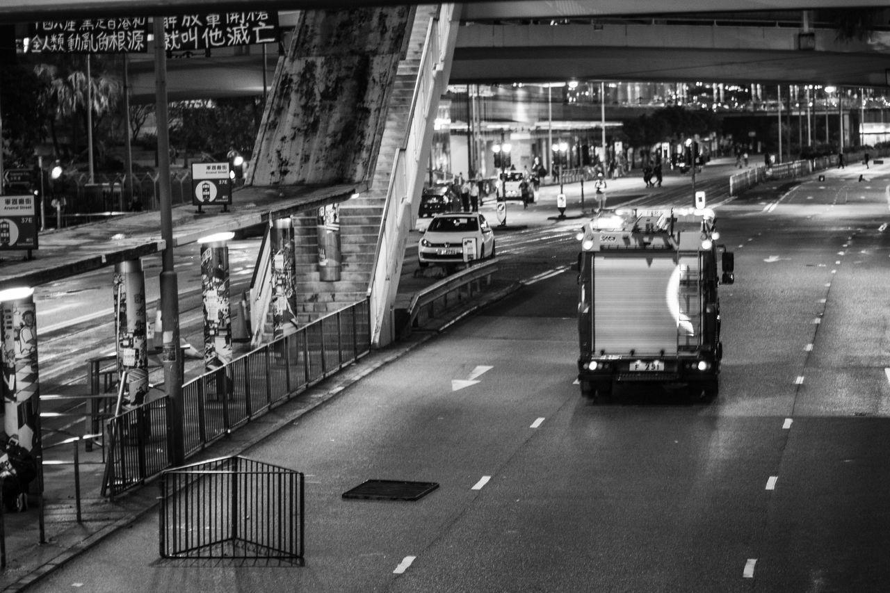 HIGH ANGLE VIEW OF ILLUMINATED STREET AT NIGHT