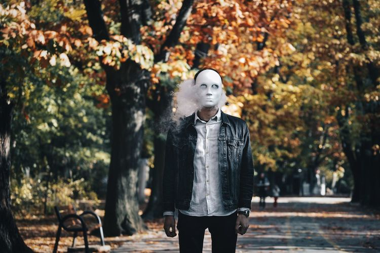 with @matthias4 Park Park - Man Made Space Smoke Smoke - Physical Structure People One Person One Man Only Men Mask Mask - Disguise Tree Autumn Leaf Standing Disguise Autumn Mood The Art Of Street Photography