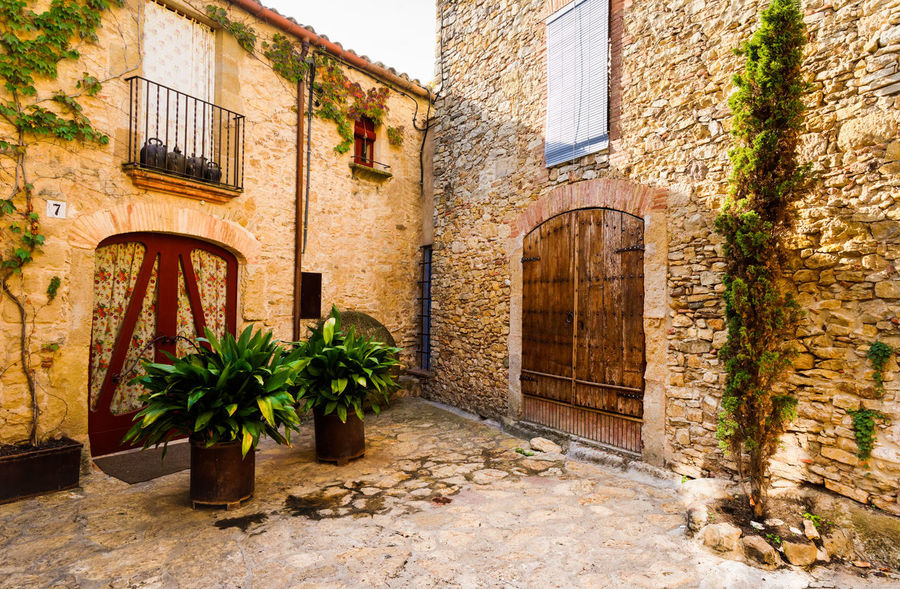 """Peratallada - """"Carved Stone' Architecture Balcony Brick Building Brick Wall Catalonia Cottage Country Life Countryside Courtyard  Curtains Doorway Lifestyles Medieval Architecture MedievalTown Mediterranean  Old Village Peratallada Plants Shadows & Lights SPAIN Travel Travel Destinations Travel Photography Traveling"""
