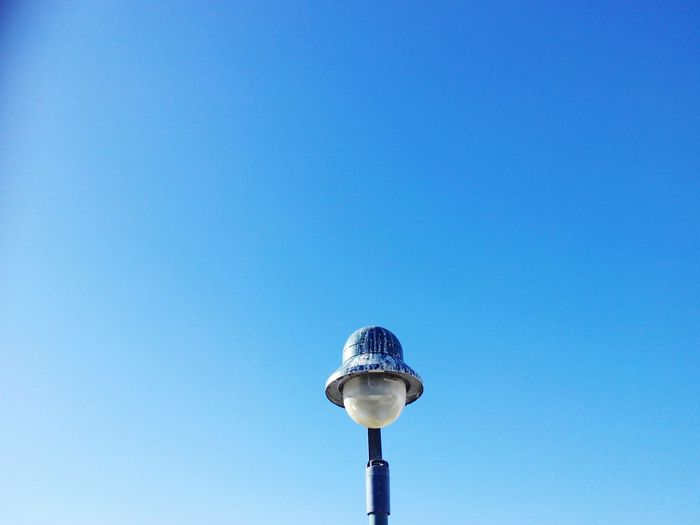 Low Angle View Of Lamp Against Clear Blue Sky