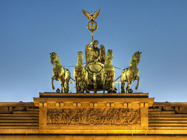 Brandenburger Gate in Berlin, Germany against clear sky Berlin Berlin Mitte Brandenburg Gate Sightseeing Animal Representation Architecture Art And Craft Brandenburger Tor Building Exterior Built Structure Clear Sky Day Germany Gold Gold Colored History Low Angle View No People Outdoors Pariser Platz Sculpture Sky Statue Travel Destination Travel Destinations Urban Icon