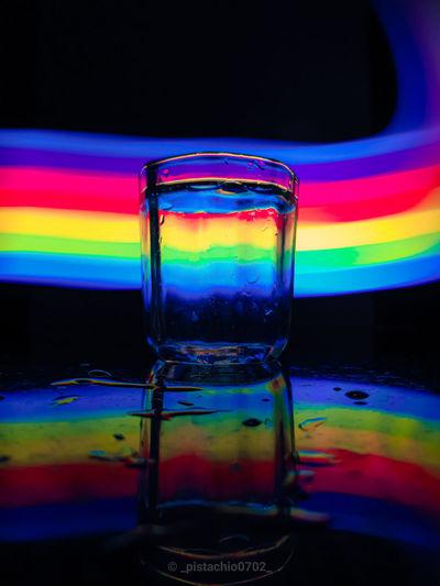 Close-up of illuminated glass against blue background
