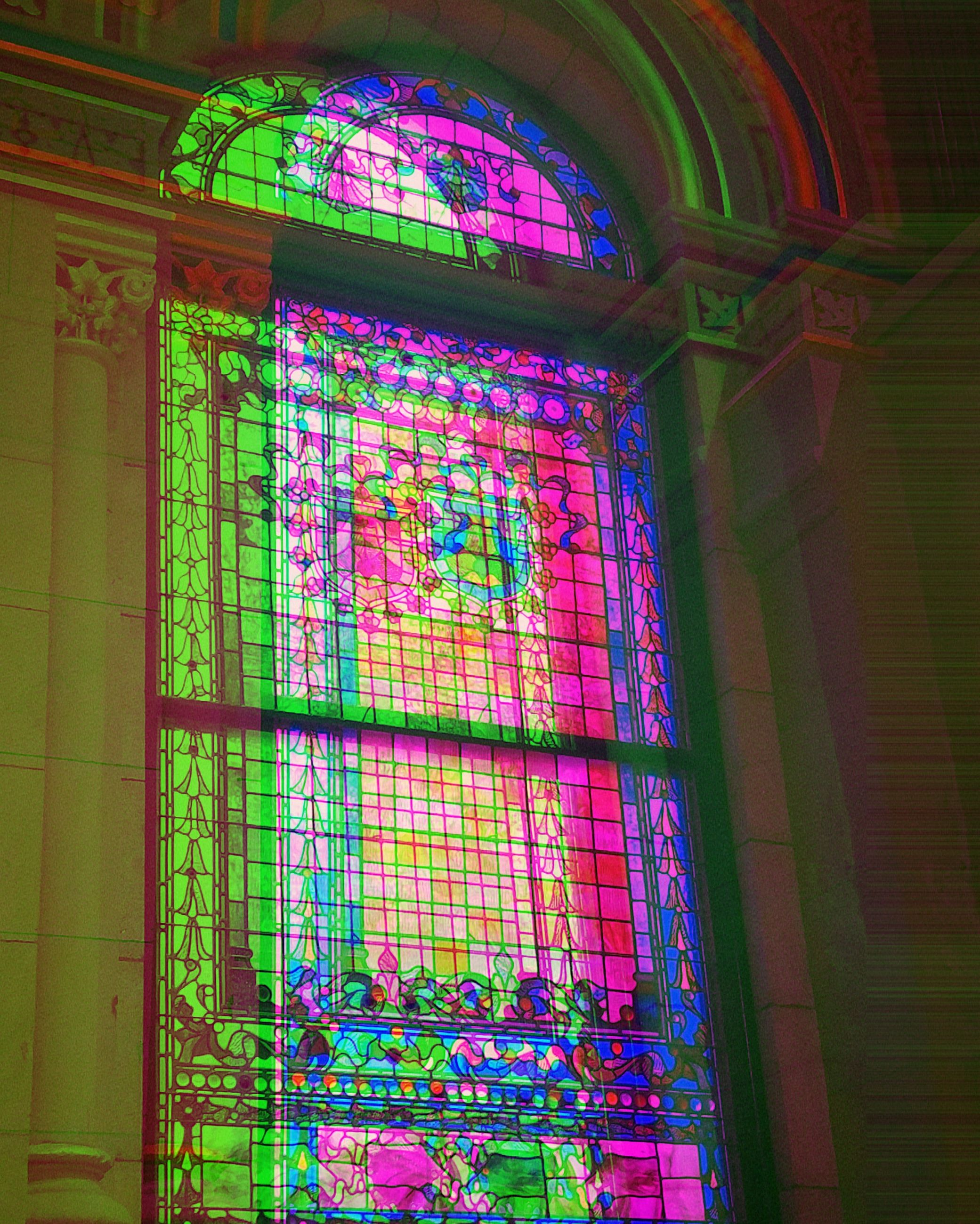 multi colored, built structure, architecture, building, no people, stained glass, low angle view, indoors, pattern, window, arch, glass, illuminated, day, wall, pink color, wall - building feature, place of worship, floral pattern