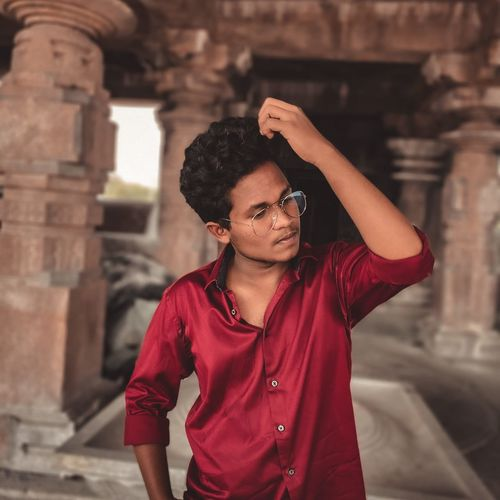 Young man standing at temple