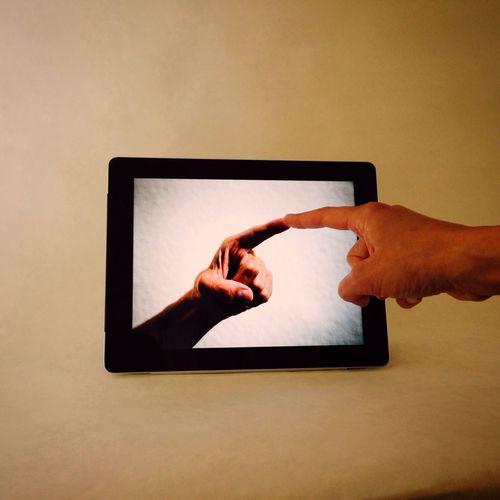 Human hand touching digital tablet