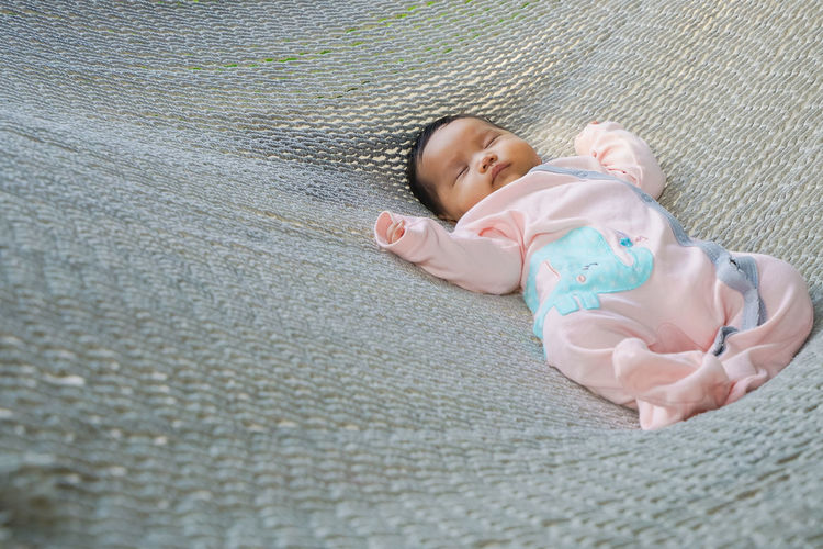 High angle view of baby sleeping in hammock