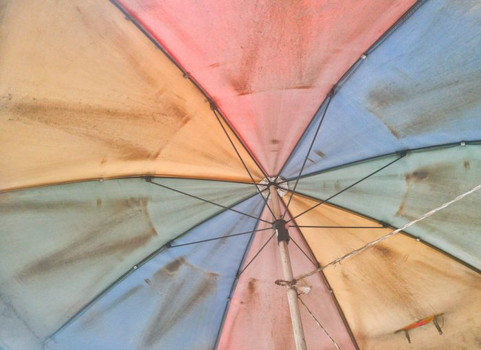 Low angle view of messy umbrella