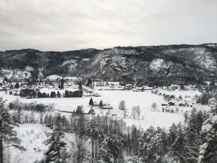 Photo of a Norwegian village Architecture Building Exterior Cold Cold Temperature Day Landscape Mountain Nature No People Outdoors Scenics Sky Snow Tranquil Scene Tranquility Tree Village White Winter