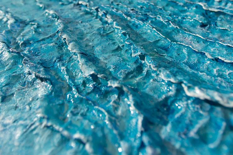 Full frame shot of blue art product