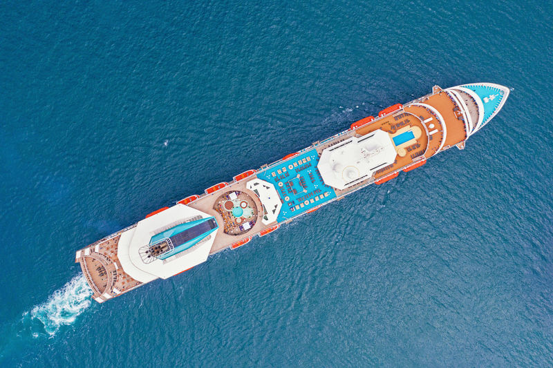 Water High Angle View Cruise Ship Nature Day Nautical Vessel No People Waterfront Outdoors Aerial View Sea Blue Transportation Business Sunlight Travel Destinations Travel Mode Of Transportation Beauty In Nature Rescue Drone View Summer Trip Minimal Mediterranean  Seascape Above View Transportation Ship Cruise Voyage
