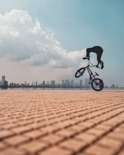 Jumping into the clouds over the city EyeEm Best Edits Eyeemphotography EyeEm Selects EyeEm Gallery EyeEmBestPics Wanderlust EyeEm Best Shots Bmx  Extreme Sports Skyline Mumbai Bmx Cycling Sky And Clouds Perspective Bicycle Transportation Sky Sport Cloud - Sky One Person Mode Of Transportation Activity Nature Ride Lifestyles Cycling Riding Outdoors Day City British Culture