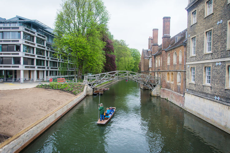 Architecture EyeEm Best Shots EyeEm Nature Lover EyeEmNewHere Mathematical Bridge Wooden Bridge Architecture Building Exterior Built Structure Cambridge Canal Day Eye4photography  Men Nature Nautical Vessel One Person Outdoors People Punting Real People Sky Transportation Tree Water Perspectives On Nature Be. Ready. The Architect - 2018 EyeEm Awards