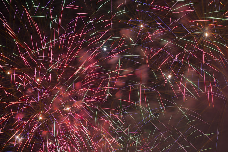 Fireworks Backgrounds Close Up Colorful Exploding Exploding Fireworks Firework - Man Made Object Firework Display Illuminated Light Painting Light Trail Long Exposure Motion Night No People Outdoors Pattern Red Color Sky Smoke - Physical Structure Sparks